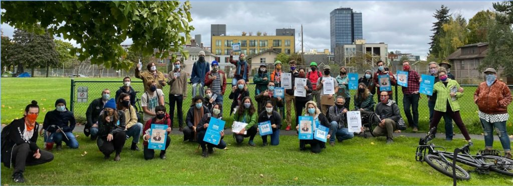 Photo of Seattle DSA members at University Playground, preparing to canvass in support of the Sherae for State campaign on a fall, overcast Seattle day.